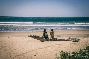 Two backpackers on the beach in Playa Guiones. Nosara. Costa Rica