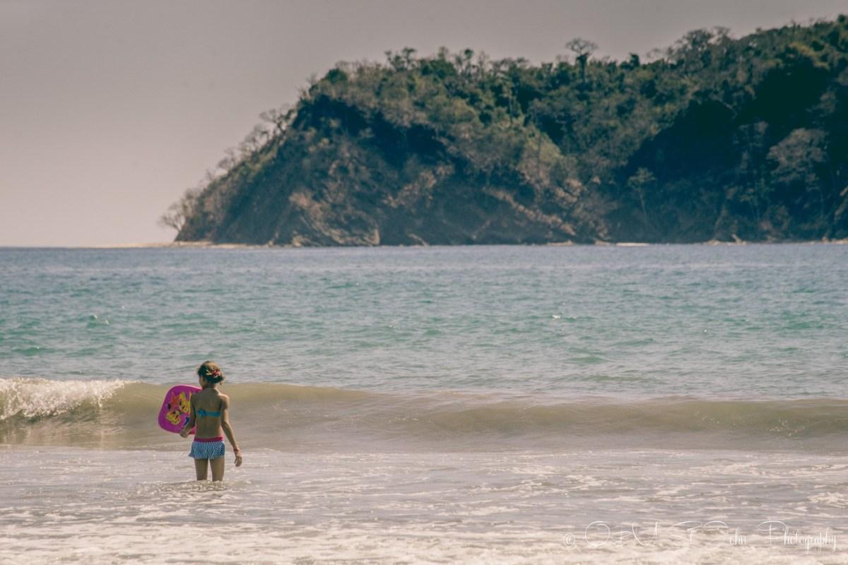 Little girl playing in the water on Playa Samara. Costa Rica