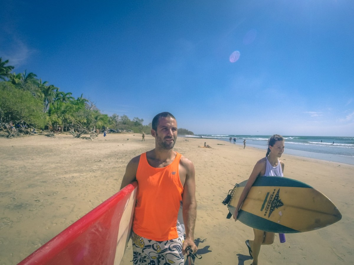 Max and Oksana heading out for a surf. Playa Avellanas. Costa Rica