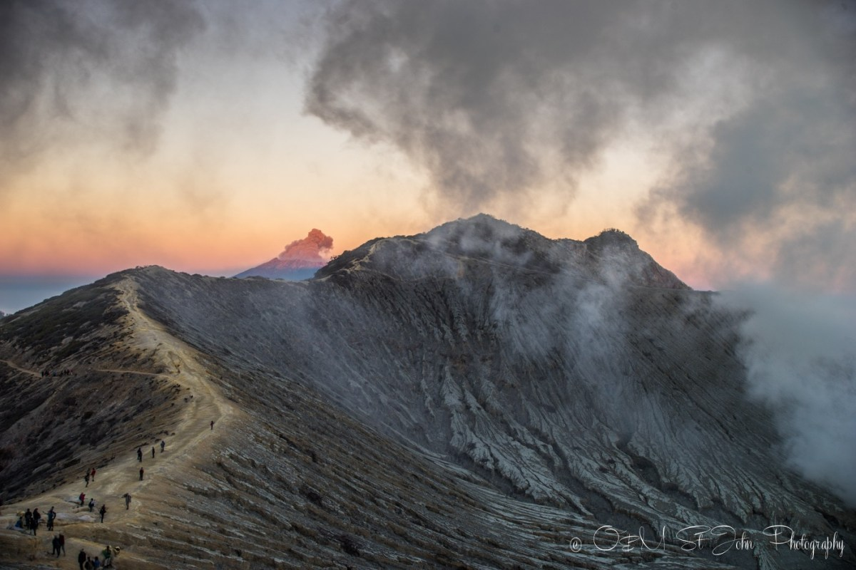 Mt Raung errupting in the distance. Ijen Crater. East Java. Indonesia