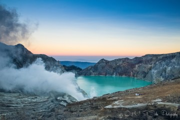 Turquoise sulfur lake of Ijen Crater. East Java, Indonesia