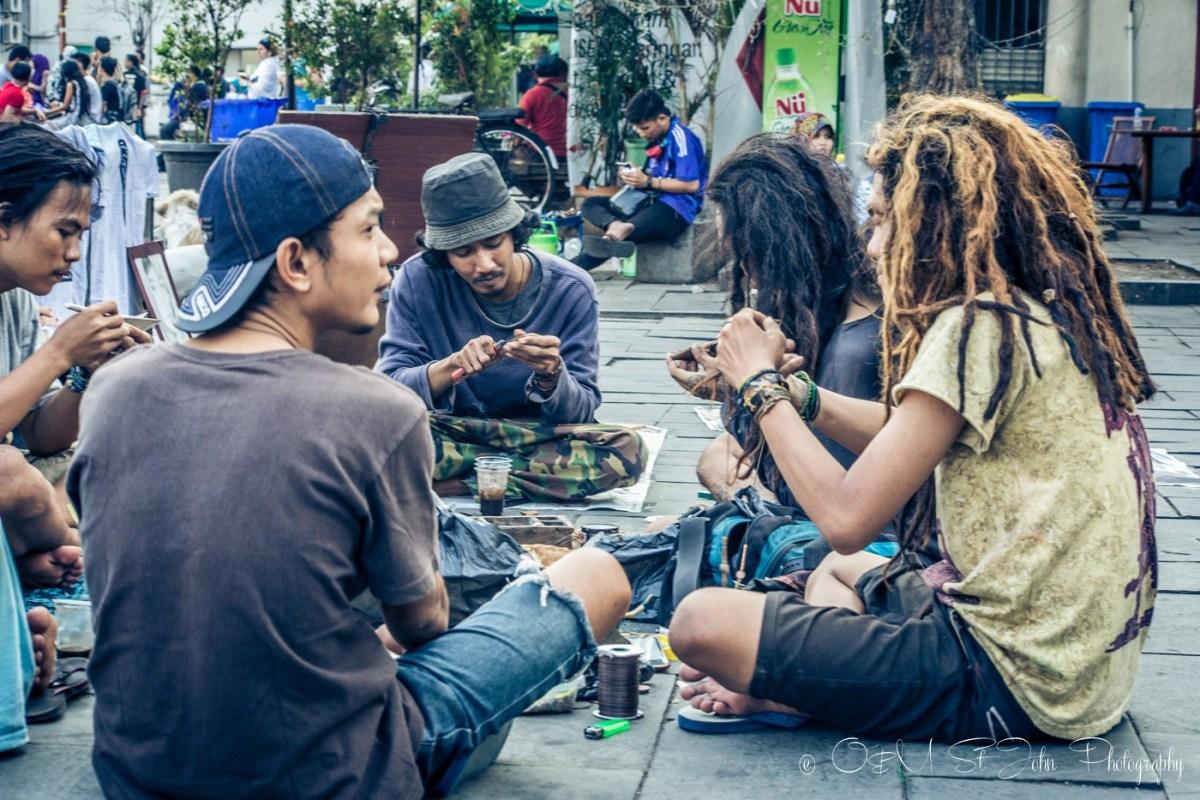 A group of rastafarians making bracelets in Taman Fatahilah, Old Jakarta