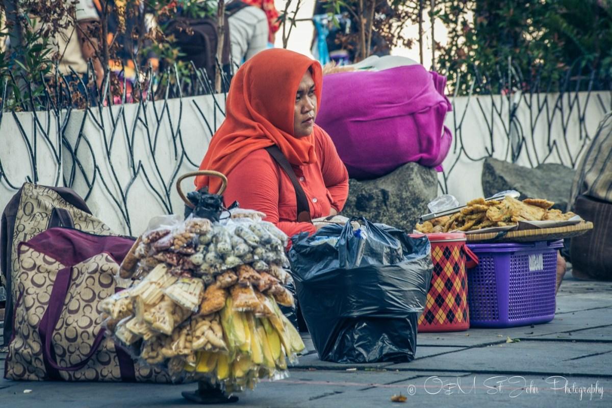 Woman selling snacks in Taman Fatahilah, Old Jakarta