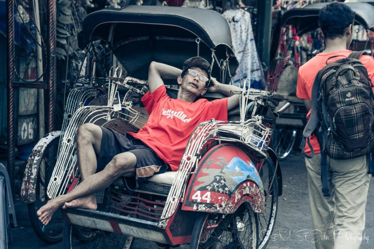 Becak driver taking a break on Jalan Malioboro. Yogyakarta. Java. Indonesia