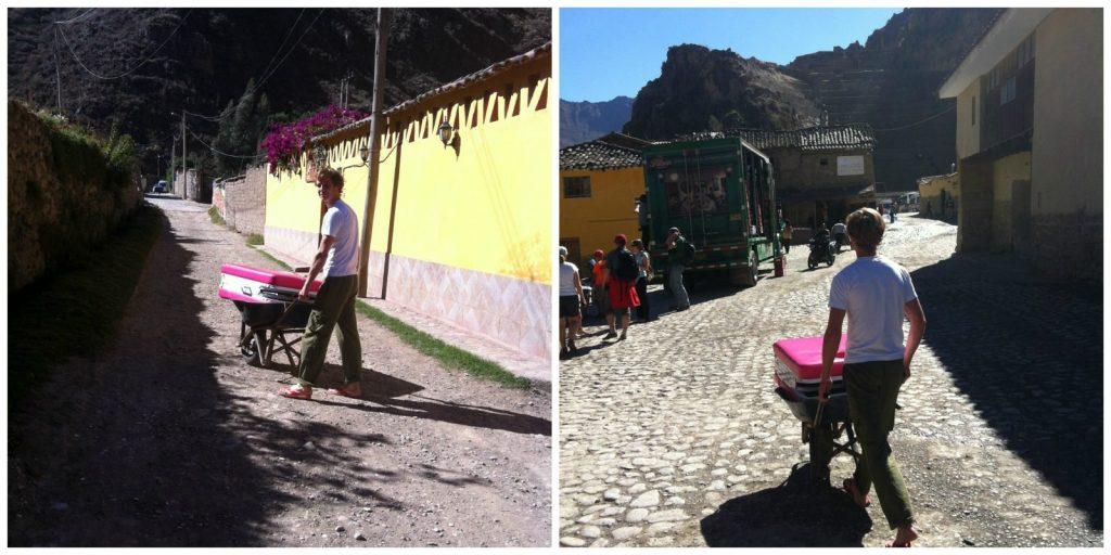 Jon pushing the wheelbarrow to promote the Massage Services. Photo courtesy Two Monkeys Travel