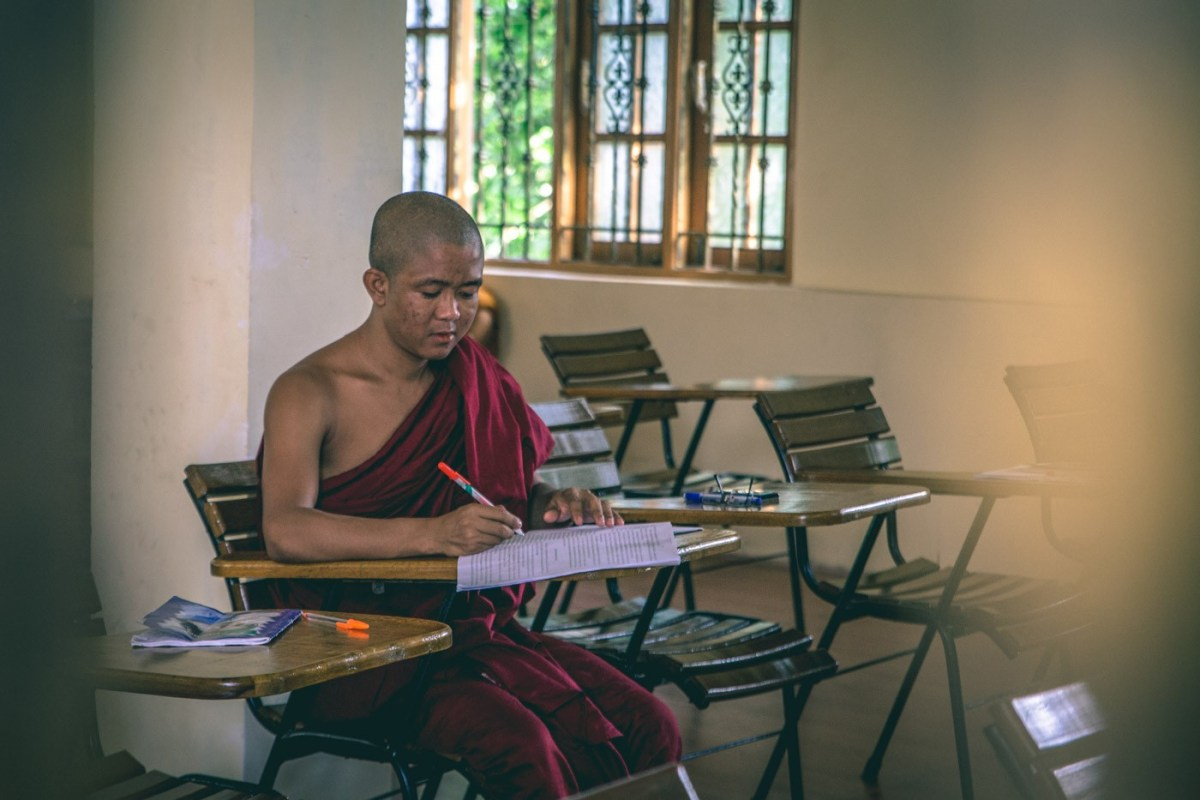Young monk taking a math lesson at a monastery in Yangon. Myanmar