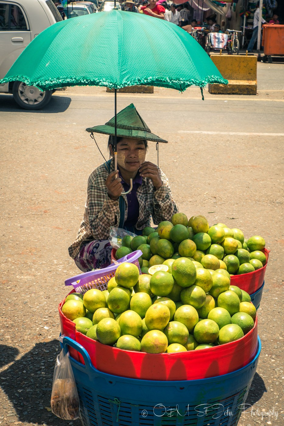 Burmese woman selling fruit at a street market in Yangon. Myanmar