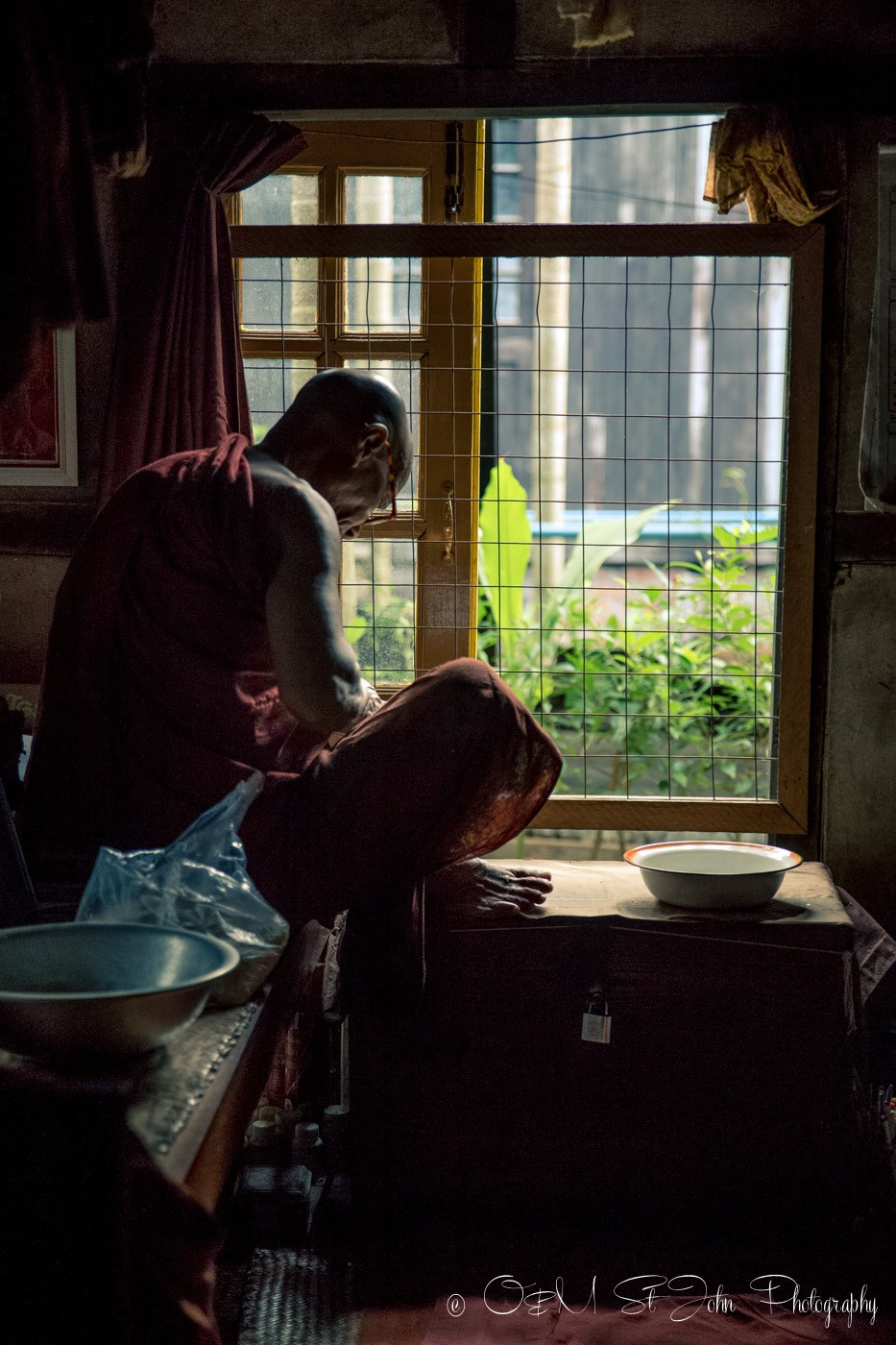Monk studying in his living quarters at a monastery in Yangon, Myanmar