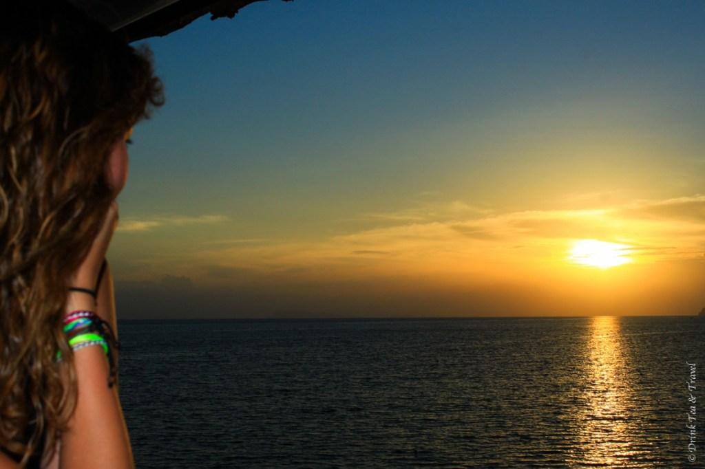 Enjoying the nomadic lifestyle, while watching a sunset on Koh Phanghan in Thailand