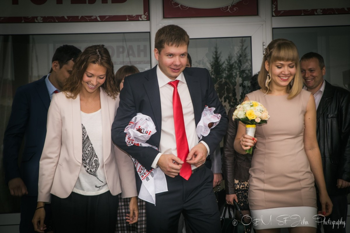 My cousin and I are escorting the groom to the bride's house. Ukrainian wedding tradition