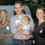 (From left to right) Deborah Yakubs, Matt Kopac, holding baby Evan, and Sarah Cottingham socialize before the sit-down portion of SEEDS' 9th Annual Harvest Dinner.