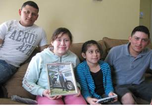 From right: Francisco Villatoro hanging out with his nieces, Nicoll and Greyci Villatoro along with his brother José Villatoro. Nicoll holds a photo of her father, Johnny Danilo Villatoro.