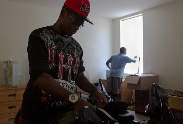 Darrius packs up the last of his things before moving as Rhamir looks out of the window of their room before leaving.