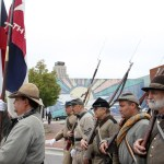 Civil War soldier reenactors march during the parade celebration for the opening of the Durham History Hub on Saturday, Oct. 12 (Staff photo by Melissa Key).
