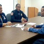 Evit Blackmon, right, meets with Kimberle Walker and Curtis Knight at the DPD Substation on Holloway Drive. Due to restricted resources, Knight is the only community resource officer for Blackmon's district.     Staff photo by Zach Potter