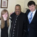 The Reverend Michael D. Page of Antioch Baptist Church, flanked by VOICE Editor (fall 2014) Zoe Schaver, left, and VOICE co-editor (spring 2014) Zach Potter on MLK Sunday. (Staff Photo by Jock Lauterer)