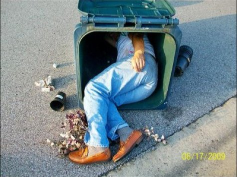 Larry Wilder in trash can