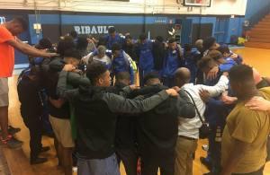 Ribault boys basketball huddle