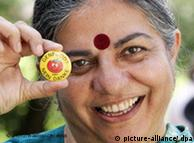Indian activist Vandana Shiva holding a pin that reads 'No thanks to GMO food'