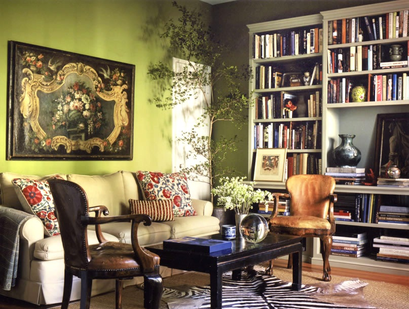 Bohemian living room with olive green wall paint along with large
