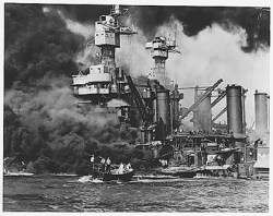 USS West Virginia burns as sailor is rescued from sea