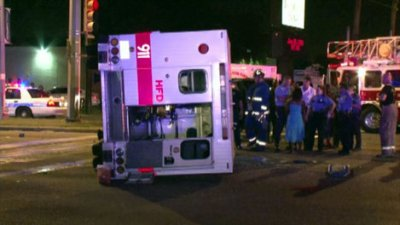 KHOU ambulance on side by DWI driver 061913