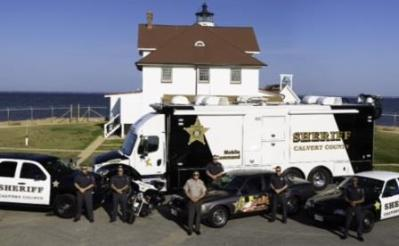 Calvert County Maryland Sheriff's Office vehicles at Cove Point Lighthouse, Chesapeake Bay.