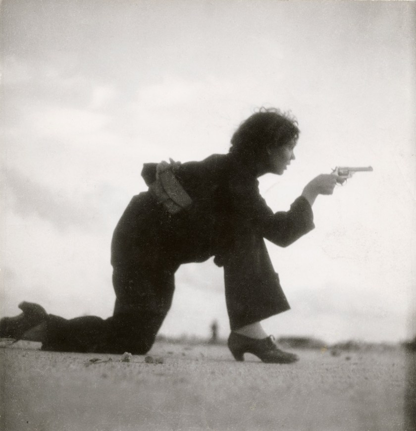 Gerda Taro, Republican militiawoman training on the beach outside Barcelona, Spain, August 1936. © International Center of Photography, New York