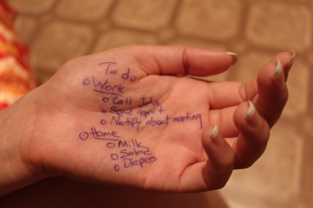 woman's hand with todo list written on it