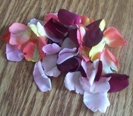 pile of rose petals on table
