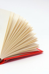open pages of book with red cover