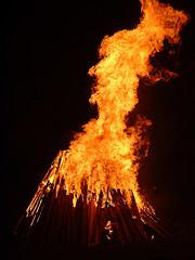 bonfire burning against dark background