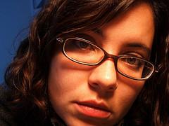 close up of girl looking sadly at camera