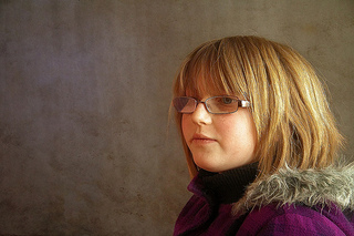 profile of girl wearing glasses looking serious