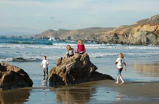 kids playing at ocean's eadge