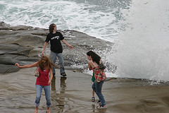kids playing near the ocean