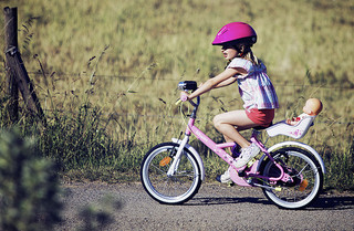 girl riding bike on path