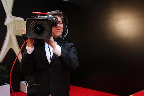 television camera man filming