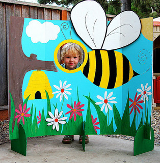 boy standing behind bumble bee photo screen