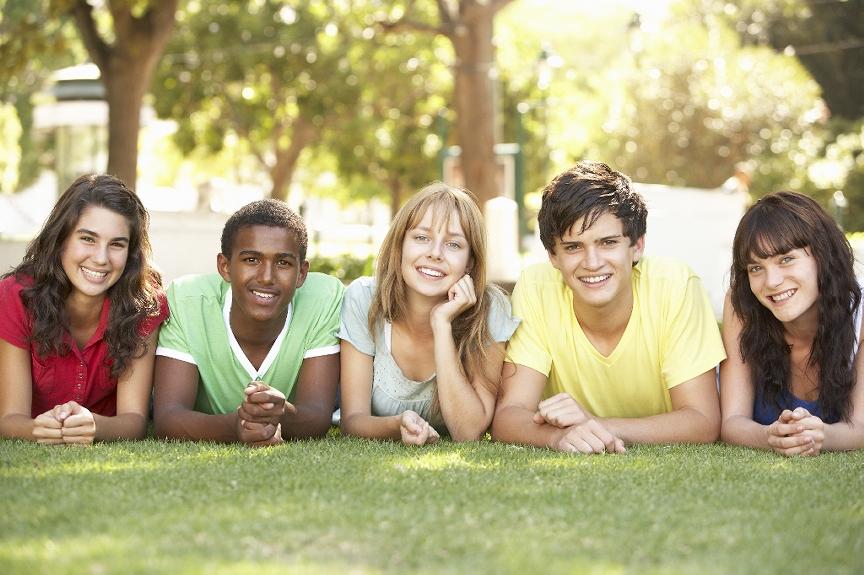 group of cheerful teens looking at camera