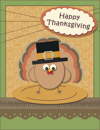 cartoon turkey standing on platter, wearing hat with caption Happy Thanksgiving