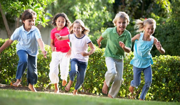 5 children running outdoors
