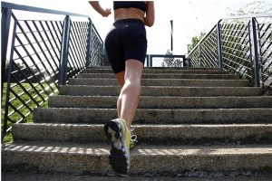 woman jogging up outdoor steps