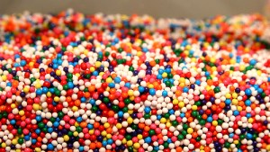 clear container of multi-colored candy sprinkles
