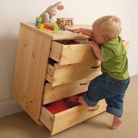 toddler climbing on tipping dresser