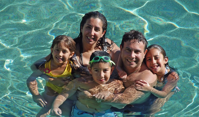 family in swimming pool together