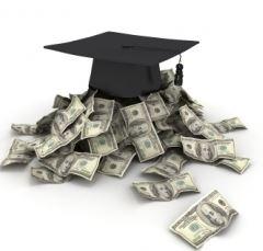 graduation cap on pile of dollars