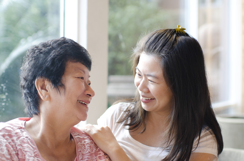 daughter smiling at her aging mother