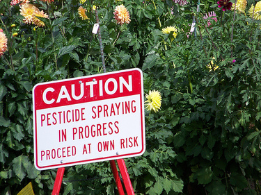 caution pesticide sign