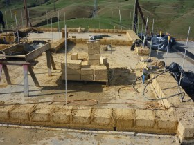 A light adobe house at the beginning of construction. Very simple building system for load-bearing walls.